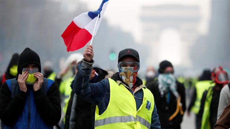 """Photo of Pad ekonomskog rasta u Francuskoj zbog protesta """"žutih prsluka"""""""