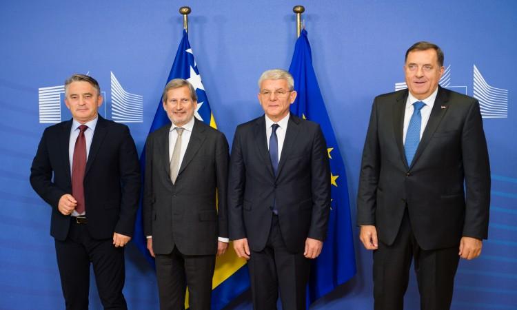 Photo of Članovi Predsjedništva BiH susreli se s komesarom Hahnom